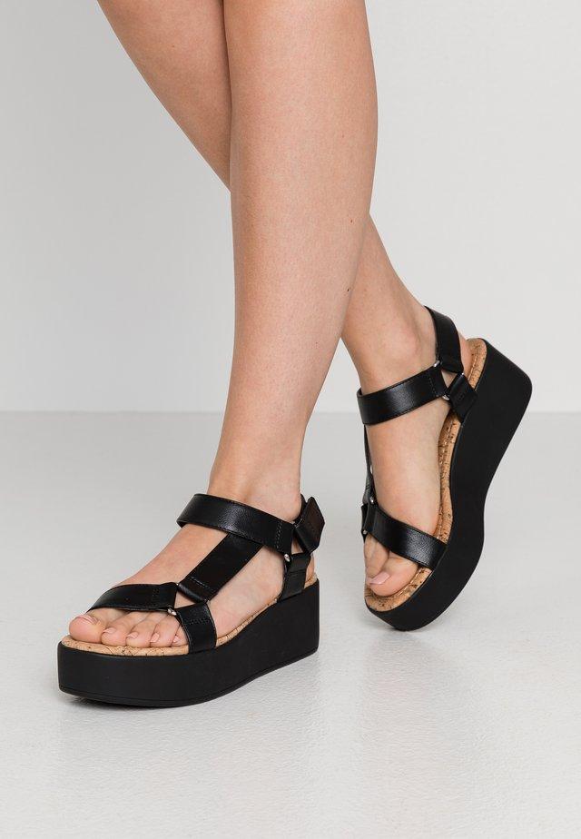 LANCYY - Korkeakorkoiset sandaalit - black