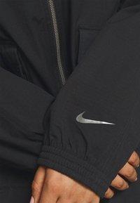 Nike Sportswear - Summer jacket - black/dark smoke grey - 4