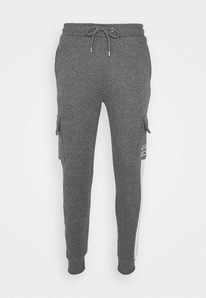 TECH UTILITY - Spodnie treningowe - charcoal