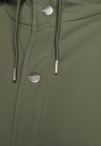 Rains - LONG JACKET UNISEX - Waterproof jacket - olive - 2