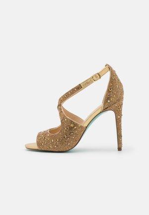 SAGE - Sandalen met hoge hak - gold