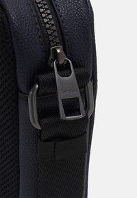 Calvin Klein - REPORTER UNISEX - Taška spříčným popruhem - blue - 4