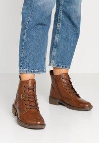 Tamaris - Lace-up ankle boots - cognac - 0