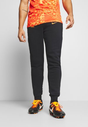 AS ROM PANT - Tracksuit bottoms - black/safety orange