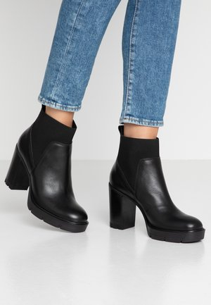 High heeled ankle boots - amanda nero