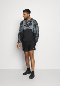 Nike Performance - SHORT - Pantalón corto de deporte - black/white - 1
