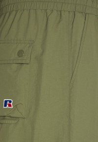 Russell Athletic Eagle R - ADMIRAL UNISEX - Cargo trousers - four leav clover - 2