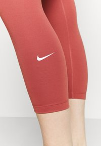 Nike Performance - ONE CROP 2.0 - Leggings - canyon rust/white
