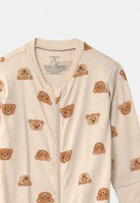 Lindex - TEDDY AT BACK UNISEX - Pyjamas - light beige - 2