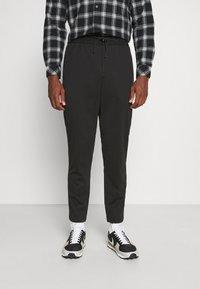 Selected Homme - SLHSLIMTAPE JIM STRING FLEX - Trousers - black - 0