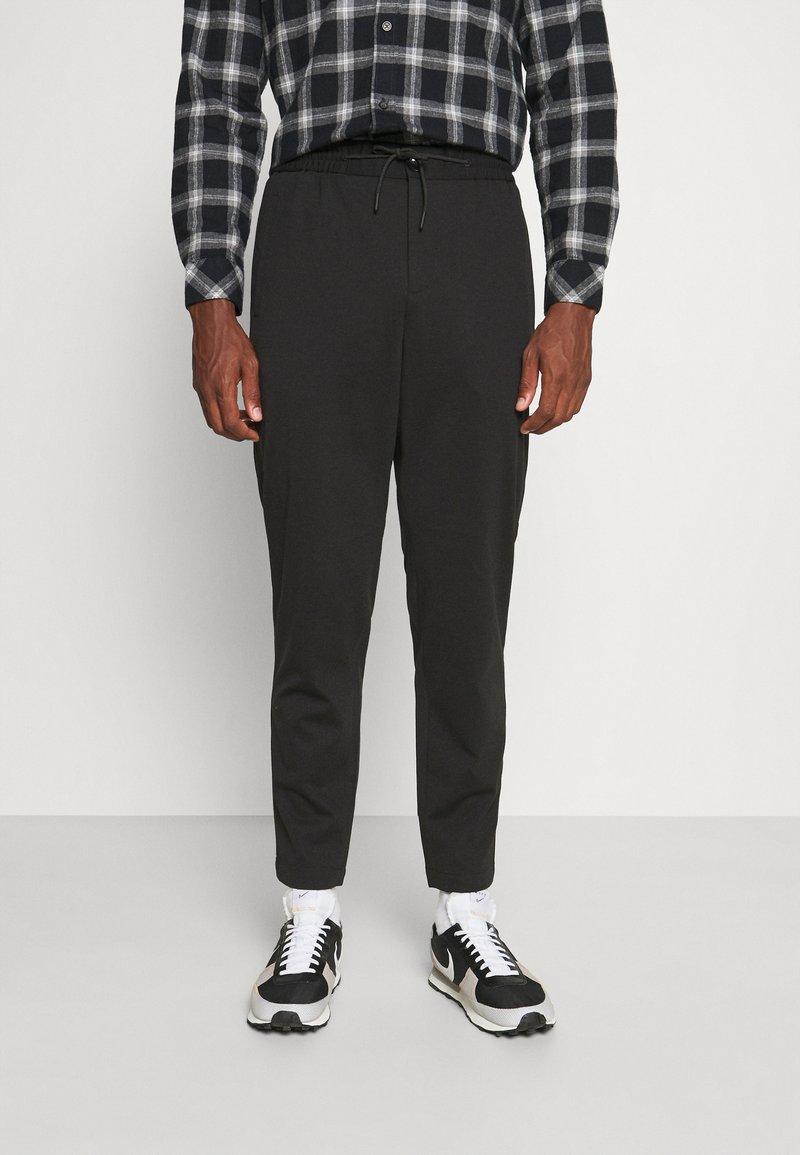 Selected Homme - SLHSLIMTAPE JIM STRING FLEX - Trousers - black