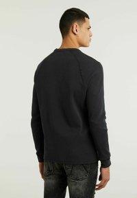 CHASIN' - FIBRE - Long sleeved top - black - 1