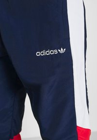 adidas Originals - TRACKPANT - Tracksuit bottoms - navy/grey/red - 4
