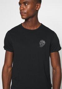 Schott - Print T-shirt - black - 6