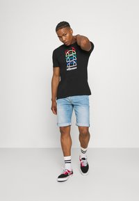 Ellesse - MAGARIO TEE - Print T-shirt - black - 1