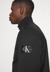 Calvin Klein Jeans - ZIP UP HARRINGTON - Bomber Jacket - black - 3
