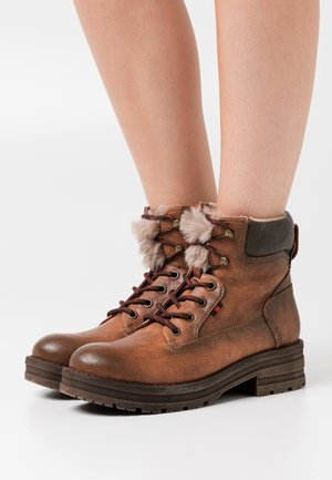 HANZEL - Platform ankle boots - brown