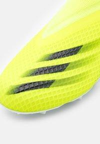 adidas Performance - X GHOSTED.3 LL FG UNISEX - Tekonurmikengät - solar yellow/core black/royal blue - 5