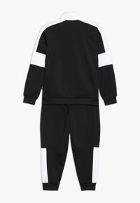 Puma - REBEL SUIT - Tracksuit - puma black - 1