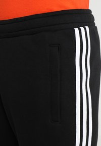adidas Originals - 3 STRIPE UNISEX - Trainingsbroek - black - 3