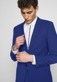 HUGO - ASTIAN HETS - Puku - bright blue - 6