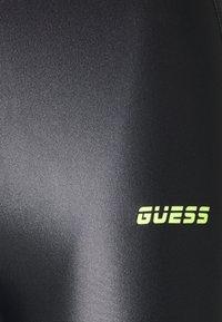Guess - LEGGINGS - Leggings - jet black - 2
