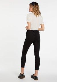 Volcom - LIBERATOR HIGH RISE - Jeans Skinny Fit - premium_wash_black - 2