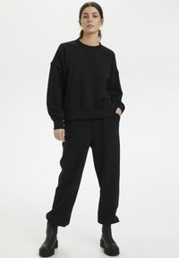 Gestuz - CHRISDAGZ - Tracksuit bottoms - black - 1