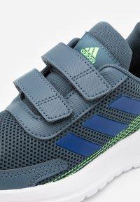adidas Performance - TENSAUR RUN UNISEX - Neutral running shoes - legend blue/royal blue/signal green - 5