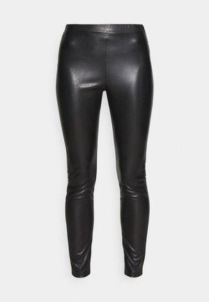 RANGHI - Leggings - Trousers - nero