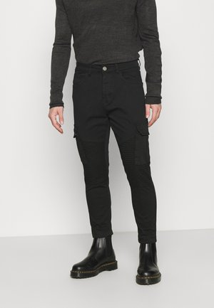 DESERTBIKER - Cargo trousers - black