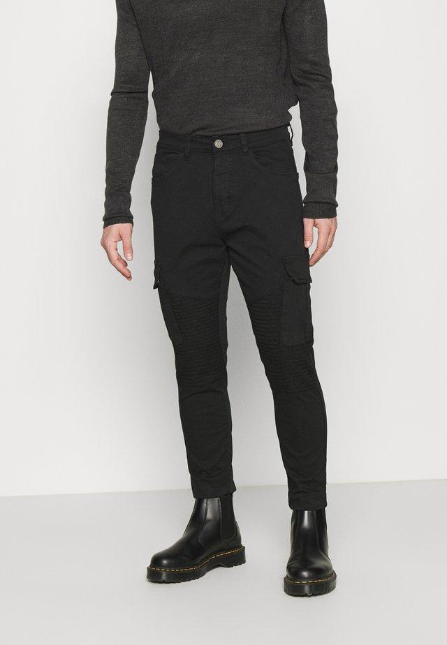 DESERTBIKER - Cargo trousers - black