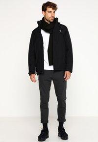 Helly Hansen - DUBLINER INSULATED JACKET - Waterproof jacket - black - 1