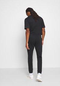 adidas Originals - ICON  - Tracksuit bottoms - black - 2