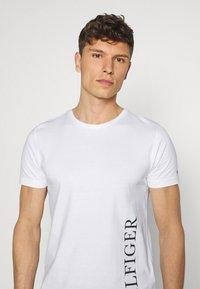 Tommy Hilfiger - SMALL LOGO TEE - Print T-shirt - white - 4