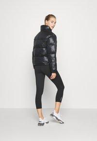 Puma - SHINE JACKET - Down jacket - black - 2