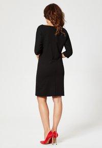 faina - Žerzejové šaty - black - 2