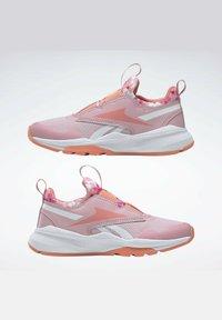 Reebok - REEBOK XT SPRINTER SLIP-ON SHOES - Stabilty running shoes - pink - 7