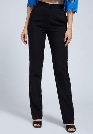 LOGO - Trousers - schwarz