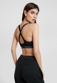 Schiesser - HIGH IMPACT - Sports bra - black - 4
