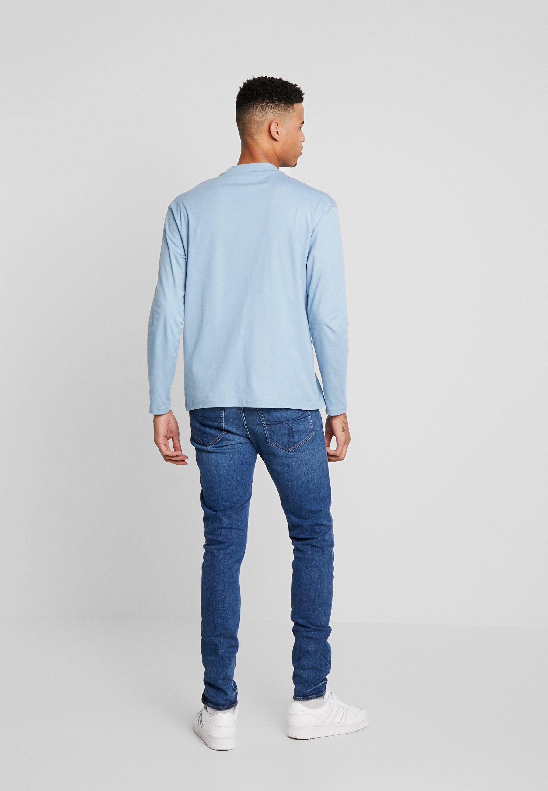 Alennukset Miesten vaatteet Sarja dfKJIUp97454sfGHYHD Tiger of Sweden Jeans EVOLVE Slim fit -farkut medium blue