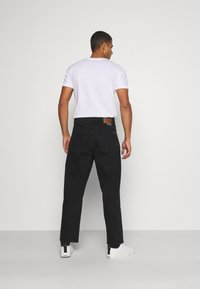Volcom - BILLOW PANT - Relaxed fit jeans - black - 2