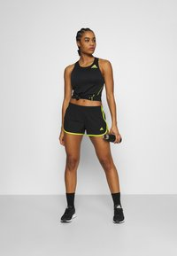 adidas Performance - M20 SHORT - Sports shorts - black/acid yellow - 1