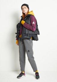 adidas Performance - PADDED - Sports jacket - berry - 2
