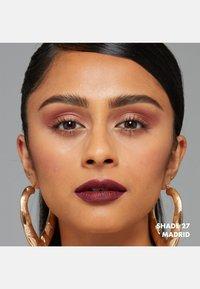 Nyx Professional Makeup - SOFT MATTE LIP CREAM - Liquid lipstick - 27 madrid - 3