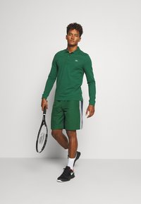 Lacoste Sport - SHORTS - Sports shorts - green - 1