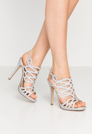 High heeled sandals - star silver