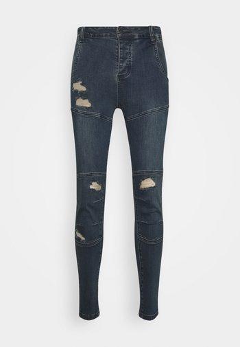 CUT SEW - Jeans Skinny Fit - indigo