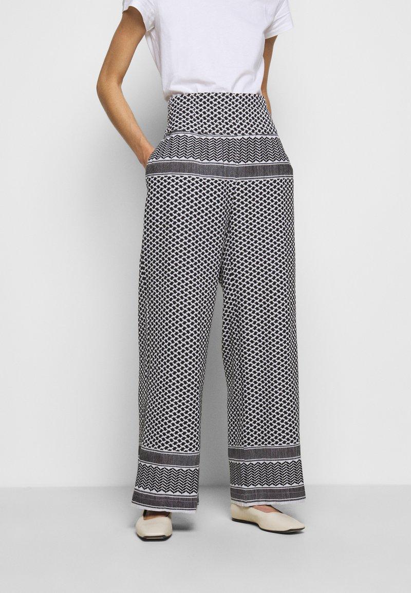 CECILIE copenhagen - BASIC TROUSERS - Trousers - black/white