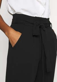 JDY - JDYTANJA  - Trousers - black - 4